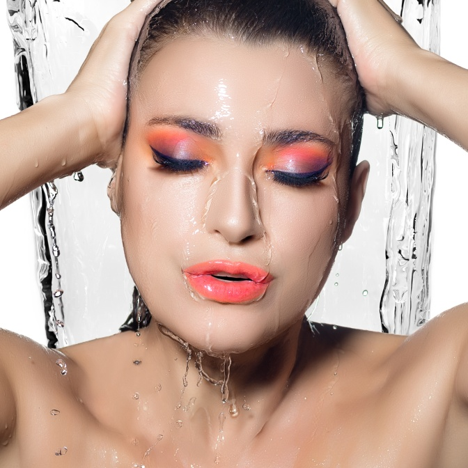 Young Beautiful Woman with Fluor Wet Makeup. Beauty and Fashion
