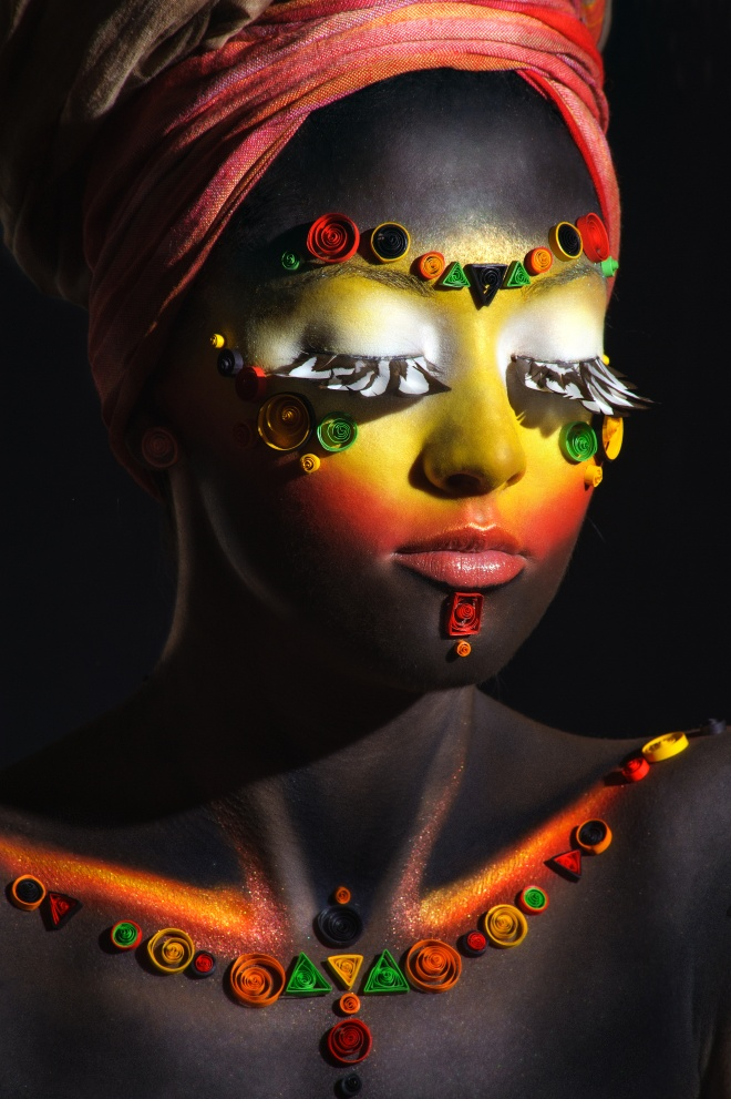 African woman with artistic ethnic makeup on her face and should