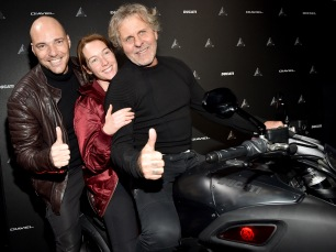 MILAN, ITALY - JANUARY 16: (L-R) Andrea Pezzi, Cristiana Capotondi and Renzo Rosso attend DDD Ducati Diavel Diesel presentation during Milan Men's Fashion Week Fall/Winter 2017/18 on January 16, 2017 in Milan, Italy. (Photo by Jacopo Raule/Getty Images for Diesel) *** Local Caption *** Renzo Rosso; Cristiana Capotondi; Andrea Pezzi