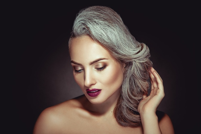 Beautiful woman with grey hair color and nice makeup