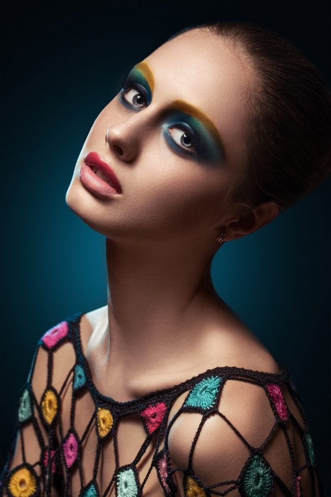 Close-up of beautiful female face with colorful make-up.Beauty.