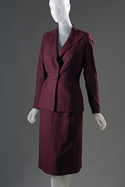 Purple and brown horizontal striped wool suit with contrast vertical stripe peaked lapel, midriff panel and skirt; semi-fitted, with shoulder pads, single waistline button, calf-length skirt