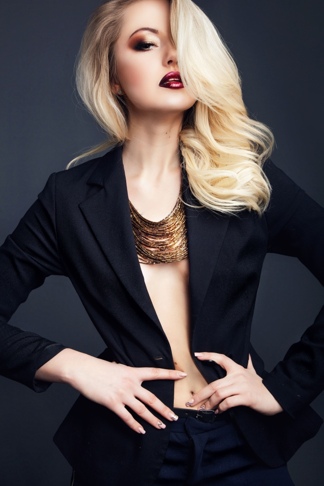 fashion studio photo of gorgeous woman with blond  hair wears bl