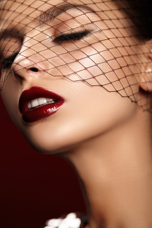 Beauty portrait of attractive girl with bright red lips