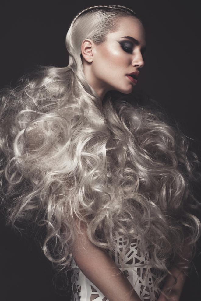 Beautiful girl in art dress with avant-garde hairstyles. Beauty face.