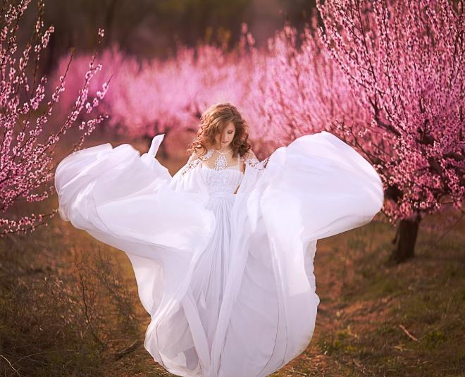 Beautiful girl in peach garden