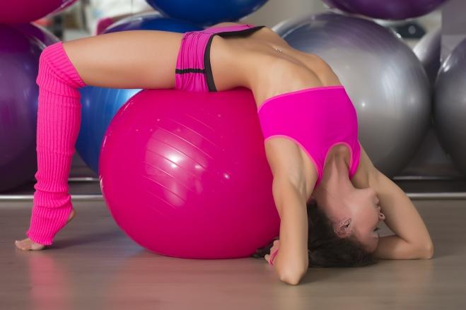 Muscular fitness girt with ball