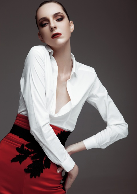 Fashion model wearing red pants and white shirt