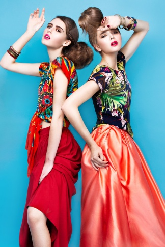 Beautiful fashionable women an unusual hairstyle in bright clothes and colorful accessories. Cuban style.